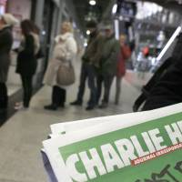 Strife-torn Charlie Hebdo opts to hand over €4 million in donations to victims of January attacks