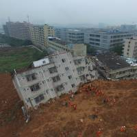 China landslide leaves 91 missing; authorities blame construction debris