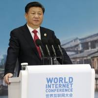 Chinese President Xi Jinping speaks during the opening ceremony of the second annual World Internet Conference in Wuzhen, Zhejiang province, on Wednesday. | REUTERS