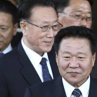 The secretaries of the Workers' Party of Korea, Choe Ryong Hae (front) and Kim Yang Gon (center), leave after a meeting with South Korean officials in Incheon, South Korea, on Oct. 4, 2014. Choe was later purged but now has been rehabilitated, and Kim has died in a car crash. | AP
