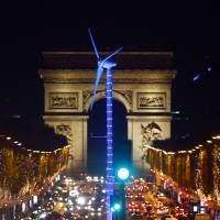 Climate talks nations close in on five-year review of pledged carbon cuts