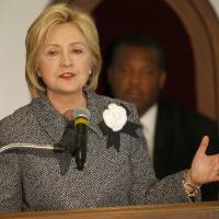 Clinton takes to MLK pulpit to mark bus boycott, calls for U.S. injustices to be remedied