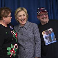 Hillary Clinton stands for a photograph during an event with campaign volunteers in Bettendorf, Iowa, Tuesday. | BLOOMBERG