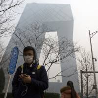 China, which emits pollutants that foul much of the air nationwide, plans to launch its first carbon-monitoring satellites next year. | AP