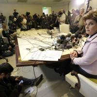 Attorney Gloria Allred, who represents 29 alleged victims of actor Bill Cosby, speaks about Cosby's arrest in Pennsylvania, at a news conference in Los Angeles Wednesda. Cosby was arrested and charged Wednesday with drugging and sexually assaulting a woman at his home 12 years ago. | AP