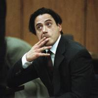 Actor Robert Downey Jr. listens in 1997 to Municipal Judge Lawrence Mira in a Malibu, California, courtroom before being sentenced to six months in jail for violating parole on a prior drug conviction. California Gov. Jerry Brown on Thursday pardoned Downey Jr. for a nearly 20-year-old felony drug conviction that sent the Oscar-nominated actor to jail for nearly a year. | AP