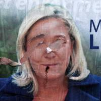 A torn poster of French far-right party leader Marine Le Pen is seen in Henin-Beaumont on Friday.   AP