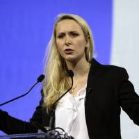 Marion Marechal-Le Pen, the National Front's regional leader for southeastern France, speaks at a campaign meeting in Marseille on Wednesday.   AP