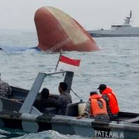 Six missing, six rescued after Danish freighter from Japan sinks in collision off Indonesia