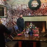 A couple visiting from Los Angeles look at the interior of a gingerbread house at the Ritz-Carlton Hotel in Marana, Arizona. | AP