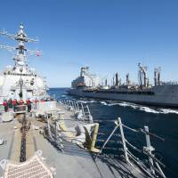 U.S.: Iran's test-firing of unguided rockets 1,500 yards from carrier in narrow strait 'unsafe, provocative'