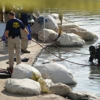 Wife linked to California massacre tried to contact wary jihad groups; lake near attack combed
