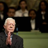 Latest brain scan turns up no cancer, Jimmy Carter tells congregation
