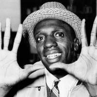 In this 1959 file photo, Meadowlark Lemon, of the Harlem Globetrotters, shows off his large hands on arrival in London, where the team was to perform at the Empire Pool in Wembley for a week. | AP