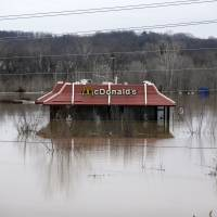 Floodwater from the Bourbeuse River surrounds a McDonald's restaurant Tuesday in Union, Missouri. | AP