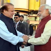 Indian Prime Minister Narendra Modi (right) shakes hands with Pakistan Prime Minister Nawaz Sharif in Lahore on Friday. | AFP-JIJI