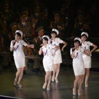Members of North Korea's all-female Moranbong Band sing and dance during a joint performance with the State Merited Chorus in Pyongyang on Oct. 11. | AP