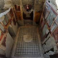 Frescoes adorn the walls of the Criptoporticus Domus, one of six restored homes that were opened to the public on Thursday at the World Heritage site of Pompeii. | AFP-JIJI