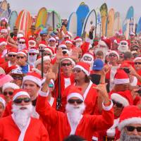 Santas hang ten by the hundreds off Cocoa Beach in Guinness quest