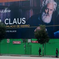 A billboard for a department store advertises Mr. Claus for the Christmas season Friday in Mexico City. | AFP-JIJI