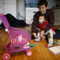 South Korean 'superdads' on paternity leave break with tradition