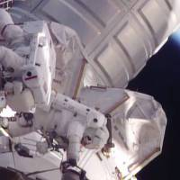 ISS spacewalkers help jog stalled rail car back into place with robotic, mission control assistance