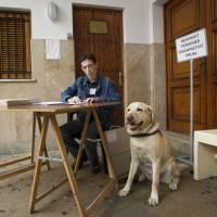 Spaniards vote in landmark election that could end two-party politics