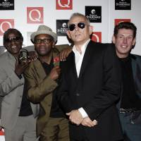 In this Oct. 26, 2009 file photo,  John Bradbury (second from right) poses with The Specials at an awards show in London. The family of Specials drummer Bradbury announced Tuesday that he died at age 62 on the previous day. | AP
