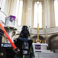 Pastors at Berlin church carry lightsabers during 'Star Wars'-themed service