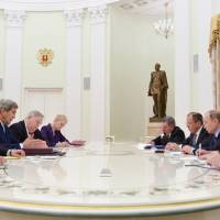 U.S. Secretary of State John Kerry (second, left) and U.S. Ambassador in Russia John Tefft (third, left) take part in a meeting with Russian President Vladimir Putin (second, right) and Russian Foreign Minister Sergey Lavrov (third, right) at the Kremlin in Moscow Tuesday. | REUTERS