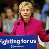 Democratic presidential candidate Hillary Clinton speaks about recent comments from Republican presidential candidate Donald Trump during a campaign stop Tuesday in Salem, New Hampshire. | AP