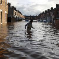Army turns out to aid rescue effort as severe floods swamp Britain