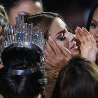 Contestants comfort Miss Colombia Ariadna Gutierrezafter she was incorrectly crowned Miss Universe at the Miss Universe pageant Dec. 20 in Las Vegas. Gutierrez told Colombia's W radio Wednesday that no one can take away the four minutes during which she wore the crown. The Colombian beauty queen who was briefly crowned Miss Universe is making the best of what she calls a humiliating situation. | AP