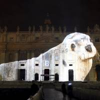 Pope hopes giant Vatican animal light show helps seal climate deal in Paris
