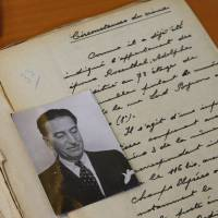 Files from the 1941 Rosenthal case are displayed at the Paris Police Prefecture Archives on Tuesday. Adolphe Rosenthal, a jeweler and diamond dealer born in Russia in 1877, was shot and killed in Paris in September 1941 under unclear circumstances. | AP