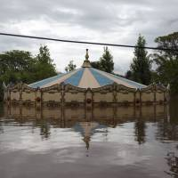 An amusement park is flooded Tuesday in Concordia, Entre Rios province, Argentina. Over recent days the storms blamed on El Nino have killed four people in Brazil and two in Argentina. | AFP-JIJI