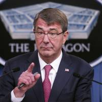 Defense Secretary Ash Carter gestures during a news conference at the Pentagon Thursday to announce that he has ordered the military to open all combat jobs to women, and is giving the armed services until Jan. 1 to submit plans to make the historic change. | AP