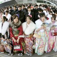 New adults attend a Coming of Age ceremony in Kobe last January. | KYODO
