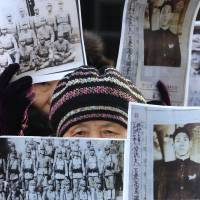 A South Korean whose relatives were victimized in World War II attends a rally in front of the Foreign Ministry in Seoul on Monday demanding full compensation and an apology from the Japanese government.  | AP