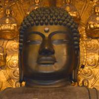 New research released Thursday shows that the Great Buddha of Nara has only half the number of spiraling curls of hair on its bronze head as are attributed to it in ancient documents. | KYODO