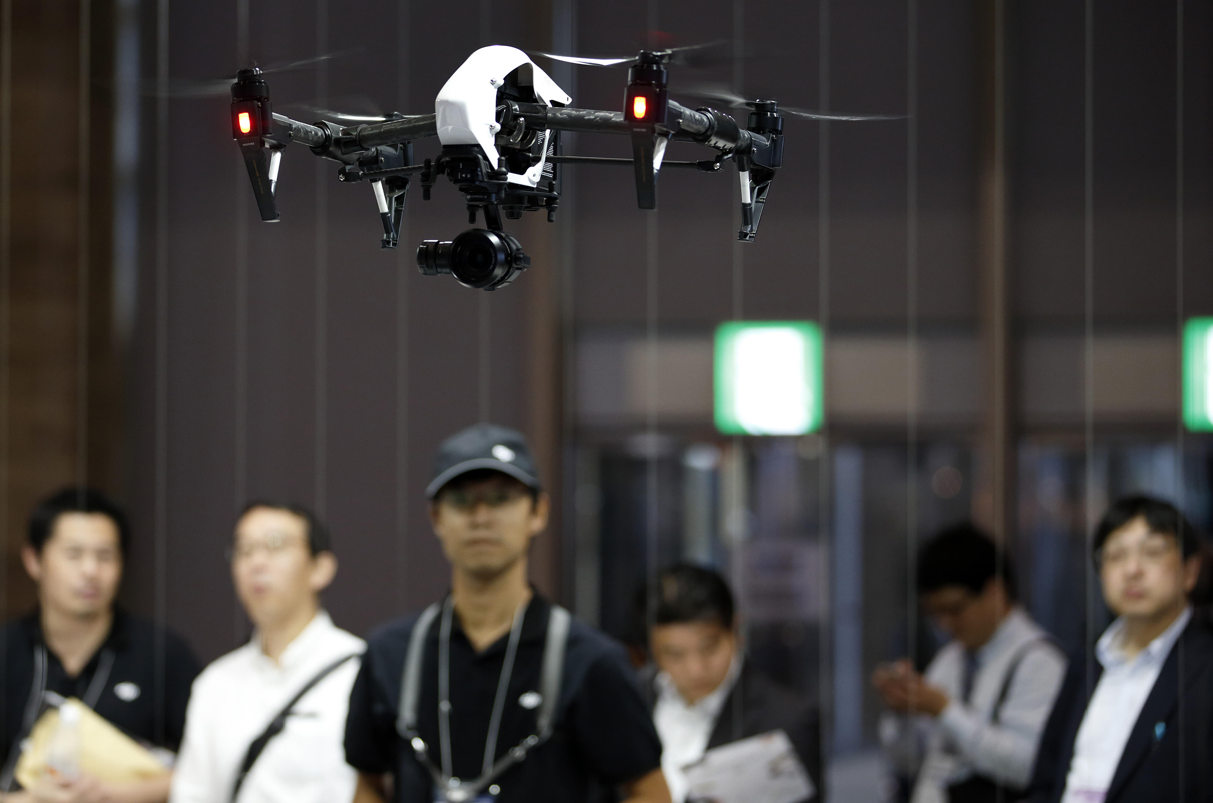 A DJI Inspire 1 drone, manufactured by SZ DJI Technology Co., flies at the Cutting-Edge IT & Electronics Comprehensive Exhibition (CEATEC) at Makuhari Messe in Chiba on Oct. 7. | BLOOMBERG