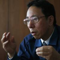 Naohiro Masuda, chief of decontamination and decommissioning of the Fukushima No. 1 nuclear plant, is interviewed at Tepco headquarters in Tokyo on Monday. | AP