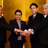 (From left) Indonesian Defense Minister Ryamizard Ryacudu, Indonesian Foreign Minister Retno Marsudi, Japanese Foreign Minister Fimio Kishida and Japanese Defense Minister Gen Nakatani prepare to kick off the first-ever two-plus-two meeting of Indonesian and Japanese foreign and defense ministers in Tokyo on Thursday. | AFP-JIJI
