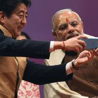 Abe-Modi deals shows Asia's top powers moving to keep rising China in check