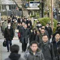 Government offices, companies mark Japan's last business day of 2015