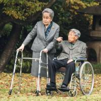 Prince Mikasa and Princess Yuriko take a walk on the grounds of the Akasaka Detached Palace in Tokyo on Nov. 16 | IMPERIAL HOUSEHOLD AGENCY/KYODO