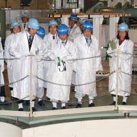 Science and technology minister Hiroshi Hase (left) inspects the Monju prototype fast-breeder nuclear reactor Wednesday in Tsuruga, Fukui Prefecture. | KYODO