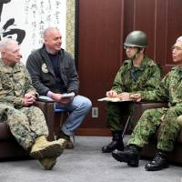 Lt. Gen. Eiji Kimizuka (right) discusses the joint Japan-U.S. response to the Great East Japan Earthquake with U.S. Marine Corps Lt. Gen. Kenneth J. Glueck Jr. at Ground Self-Defense Force Camp Sendai in Miyagi Prefecture on March 15, 2011. | U.S. MARINE CORPS