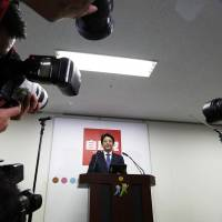 Prime Minister Shinzo Abe poses ahead of a news conference following his reappointment as leader of the ruling Liberal Democratic Party in Tokyo on Sept. 23. | BLOOMBERG