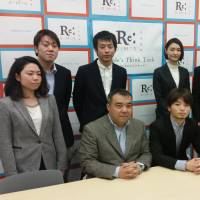 Aki Okuda (seated, center) and other members of Students Emergency Action for Liberal Democracy (SEALDs) announce the launch of a new think tank, ReDemos, in Tokyo on Monday. Seated at left is Koichi Nakano, a political science professor at Sophia University, and seated at right is attorney Takahisa Mizukami.   TOMOHIRO OSAKI